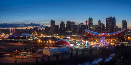 CALGARY, CANADA - JULY 8: Panoramic view of the the Calgary Stampede at sunset on July 8, 2016 in Calgary, Alberta. The Calgary Stampede is often called the greatest outdoor show on Earth