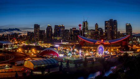 calgary stampede: CALGARY, CANADA - JULY 8: Panoramic view of the the Calgary Stampede at sunset on July 8, 2016 in Calgary, Alberta. The Calgary Stampede is often called the greatest outdoor show on Earth. Editorial