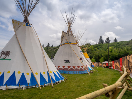 CALGARY, CANADA - JULY 9: View of Tipis in the Indian Village at the Calgary Stampede on July 9, 2016 in Calgary, Alberta. The Indian Village represents First Nations people at the Calgary Stampede. Editorial
