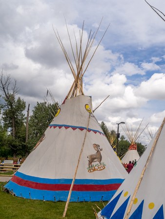 cree: CALGARY, CANADA - JULY 9: View of Tipis in the Indian Village at the Calgary Stampede on July 9, 2016 in Calgary, Alberta. The Indian Village represents First Nations people at the Calgary Stampede. Editorial