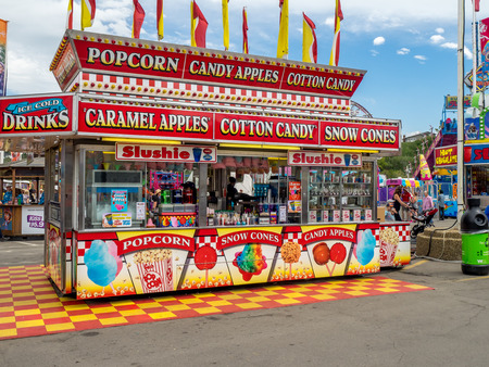 stampede: CALGARY, CANADA - JULY 9: Confection booth at the the Calgary Stampede midway on July 9, 2016 in Calgary, Alberta. The Calgary Stampede is often called the greatest outdoor show on Earth. Editorial