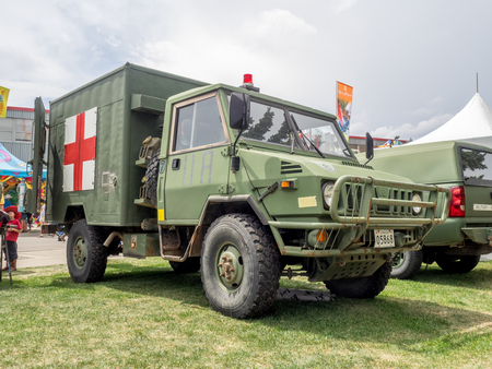 calgary: CALGARY, CANADA - JULY 9: Military ambulance exhibit at the the Calgary Stampede midway on July 9, 2016 in Calgary, Alberta. The Calgary Stampede is often called the greatest outdoor show on Earth.