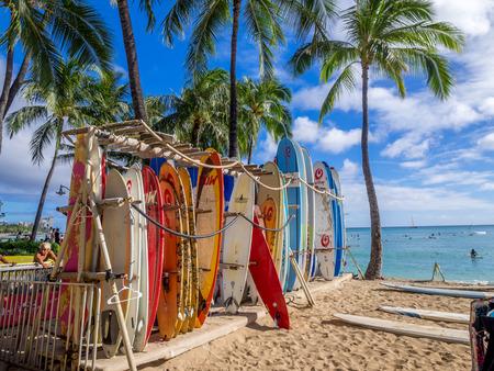 Surf rental shop on Waikiki beach on August 2, 2016 in Honolulu, Usa. Waikiki beach is neighborhood of Honolulu, best known for white sand and surfing.