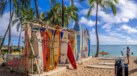 Surf rental shop on Waikiki beach on August 2, 2016 in Honolulu, Usa. Waikiki beach is neighborhood of Honolulu, best known for white sand and surfing.