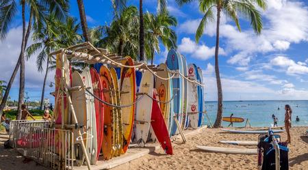 surf shop: Surf rental shop on Waikiki beach on August 2, 2016 in Honolulu, Usa. Waikiki beach is neighborhood of Honolulu, best known for white sand and surfing.