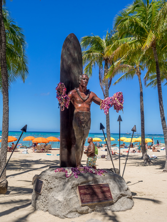 popularized: Duke Kahanamoku Statue on Waikiki Beach on August 3, 2016 in Honolulu. Duke famously popularized surfing and won gold medals for the USA in swimming.