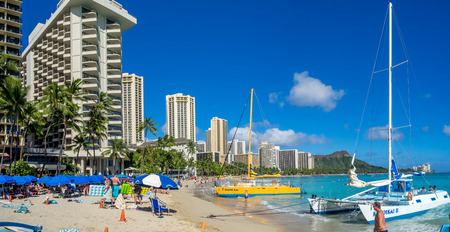 HONOLULU, HI - AUG 4: A catamaran waiting for tourists at Waikiki Beach on August 4, 2016 in Honolulu. Catamarans are a popular tourist activity at Waikiki Beach and offers a unique experience. Editorial