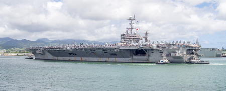 oahu: OAHU, HI - AUG 5, 2016: The USS John C. Stennis on August 5, 2016 in Pearl Harbor, USA. The John C. Stennis is a Nimitz class nuclear powered aircraft carrier..