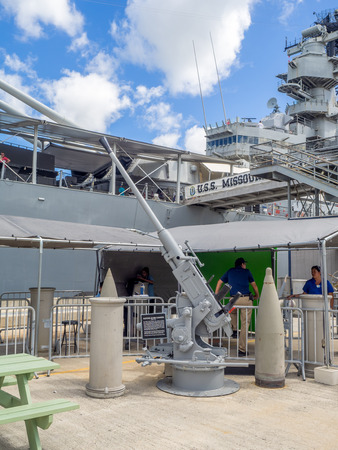 OAHU, HI - AUG 5, 2016: The USS Missouri battleship on August 5, 2016 in Pearl Harbor, USA. Site of the treaty signing ending WWII between the US and Japan, is now berthed in Pearl Harbor. Editorial