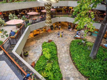 refurbished: HONOLULU, HI - AUG 6: Garden courtyard view of the refurbished Royal Hawaiian Shopping Centre on August 6, 2016 in Honolulu. Waikiki tourists enjoy the many stores and restaurants.