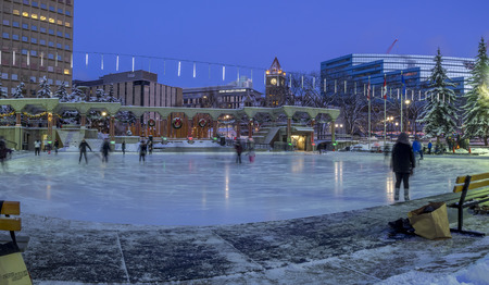 december 25: CALGARY, CANADA - DEC 25: Families ice skating at Olympic on December 25, 2016 in Calgary, Alberta. The ice skating at Olympic Plaza is a popular winter activity for Calgarians. Editorial