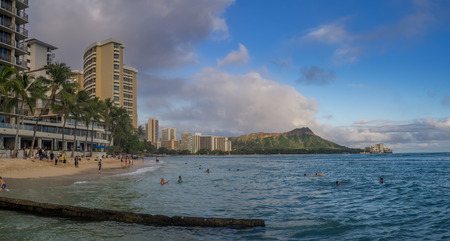 HONOLULU, USA: Sun lovers on Waikiki beach in Honolulu, Usa. Waikiki beach is neighborhood of Honolulu, best known for white sand and surfing.