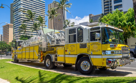 HONOLULU, USA - AUG 8: Firetruck along famous on Waikiki beach on August 8, 2016 in Honolulu, Usa. Waikiki beach is neighborhood of Honolulu, best known for white sand and surfing.