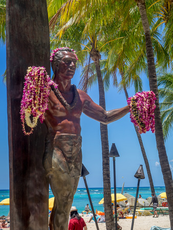 popularized: HONOLULU, USA - AUG 8: Duke Kahanamoku Statue on Waikiki Beach on August 8, 2016 in Honolulu. Duke famously popularized surfing and won gold medals for the USA in swimming.