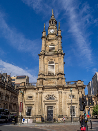 GLASGOW, SCOTLAND - JULY 20: Tourists near St Georges Tron Church on July 20, 2017 in Glasgow, Scotland. The building was opened in 1808, originally as St. Georges Parish Church.