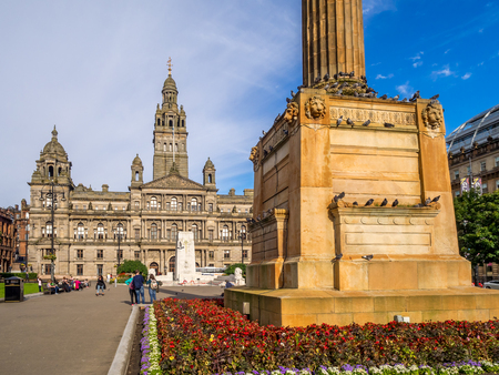 GLASGOW, SCOTLAND - JULY 20: George Square on July 20, 2017 in Glasgow, Scotland. George Square is the principal civic square in the city of Glasgow. It is named after King George III.