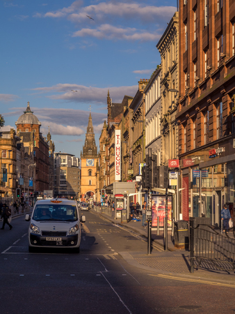GLASGOW SCOTLAND - JULY 20: Argyle Street in central Glasgow at sunset on July 20, 2017 in Glasgow, Scotland. Argyle Street is a main commercial street in the city. Editorial