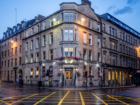 GLASGOW, SCOTLAND - JULY 20: The Piper Bar on July 20, 2017 in Glasgow, Scotland. The Piper Bar is a popular pub and whisky bar across the street from George Square. Editorial