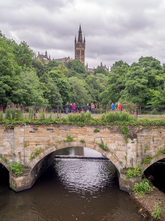 Towers of University of Glasgow in Glasgow Scotland along the Kelvin River.