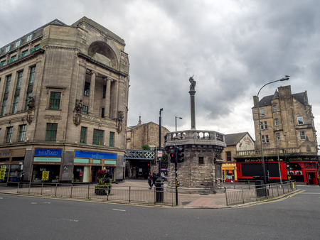 GLASGOW, SCOTLAND - JULY 21: The Mercat Cross which stands at the south-eastern corner of Glasgow Cross on July 21, 2017 in Glasgow, Scotland. The cross historically marked a legal market.