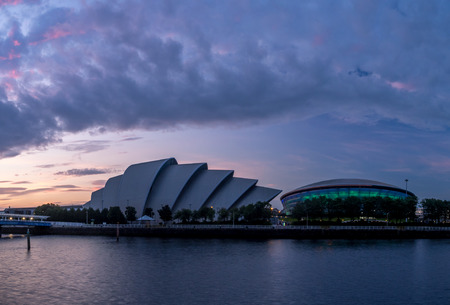 GLASGOW, SCOTLAND - JULY 21: The River Clyde with the Millennium Bridge, the SEC Armadillo and SEE Hydro on July 21, 2017 in Glasgow, Scotland. The Armadillo is Glasgow main conference space. Editorial