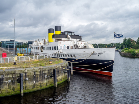GLASGOW, SCOTLAND - JULY 22: The TS Queen Mary on the River Clyde on July 22, 2017 in Glasgow Scotland. It is a retired Clyde steamer launched in 1933 and is now being preserved as a museum ship.