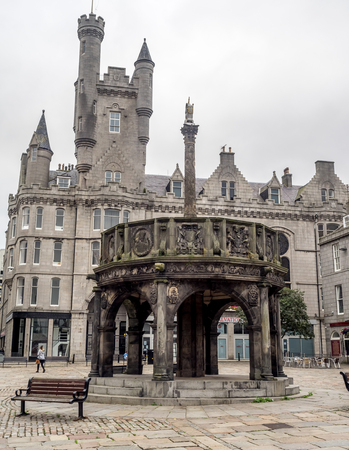 ABERDEEN, SCOTLAND - JULY 24: The Mercat Cross in the main square on July 24, 2017 in Aberdeen, Scotland. The mercat cross marked the royally sanctioned market location in Scotland. Editöryel