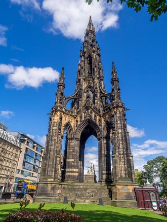 EDINBURGH, SCOTLAND - JULY 26: Statue of Sr Walter Scott at the base of the Scott Monument at night on July 26, 2017 in Edinburgh Scotland. Scott is Scotlands most famous writer