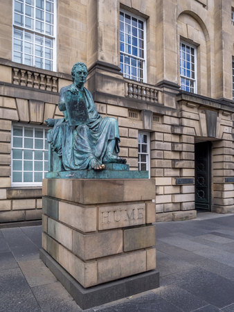 EDINBURGH, SCOTLAND - JULY 29: The statue of David Hume situated in front of the High Court Building on the Royal Mile on July 29, 2017 in Edinburgh, Scotland. Hume is a famous Scottish philosopher.