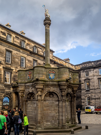 EDINBURGH, SCOTLAND - JULY 26: The Mercat Cross of Edinburgh stands in Parliament Square on July 26, 2017. It is next to St Giles Cathedral, facing the High Street in the Old Town of Edinburgh Editorial