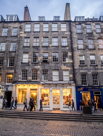 EDINBURGH, SCOTLAND - JULY 28: Tourist shops along the Royal Mile on July 28, 2017 in Edinburgh, Scotland. There are many such shops on the Royal Mile serving tourists with kilts, shirts, etc. Editorial