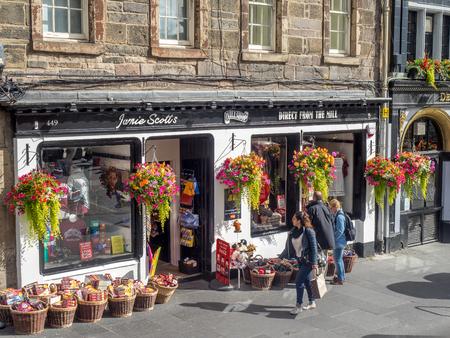 EDINBURGH, SCOTLAND - JULY 29: Tourist shops along the Royal Mile on July 29, 2017 in Edinburgh, Scotland. There are many such shops on the Royal Mile serving tourists with kilts, shirts, etc.