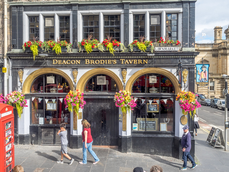 EDINBURGH, SCOTLAND - JULY 29: Deacon Brodies Pub along the Royal Mile on July 29, 2017 in Edinburgh, Scotland. There are many such pubs on the Royal Mile serving tourists with whisky, beer, etc. Editorial