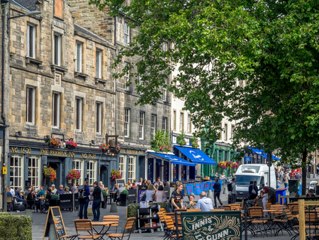 EDINBURGH, SCOTLAND - JULY 30: Buildings and shops in the famous Grassmarket ares of the Old Town on July 30 2017 in Edinburgh, Scotland. The Grassmarket is a popular area of Edinburgh.