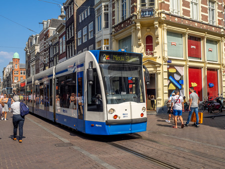 Amsterdam, Netherlands - July 21, 2018: Tram on the busy shopping street of Leidsestraat in the centre of Amsterdam, Netherlands.