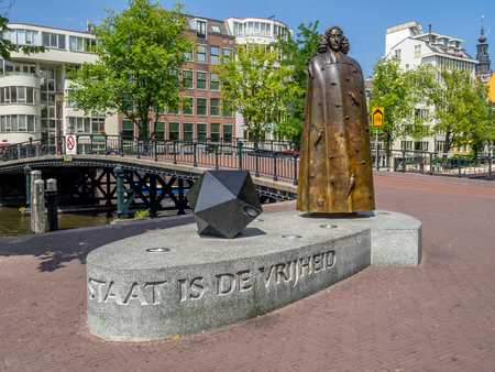 Amsterdam, Netherlands - July 22, 2018: Spinoza monument in the centre of Amsterdam. There are many monuments around Amsterdam.