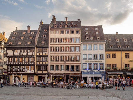 Strasbourg, France - July 25, 2018: Beautiful buildings in Cathedral Square of Strasbourg in the Alsace region of France. Many structures are of the traditional half timbered architecture.