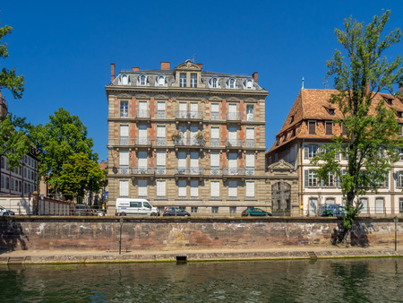 Strasbourg, France - July 26, 2018: Beautiful buildings in Cathedral Square of Strasbourg in the Alsace region of France. Many structures are of the traditional half timbered architecture.