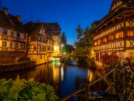 Strasbourg, France - July 26, 2018: Beautiful buildings in the heart of Petite France in Strasbourg in the Alsace region of France. Many structures are of the traditional half timbered architecture. Éditoriale