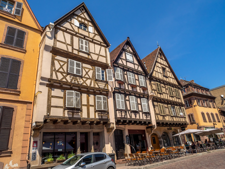 Colmar, France - July 27, 2018: Beautiful buildings in the heart of medieval Colmar in the Alsace region of France. Many structures are of the traditional half timbered architecture.
