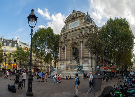 Paris, France - August 1, 2018: Fontaine Saint-Michel in the heart of Paris France. The area in front of the fountain is a popular gathering spot for locals and tourists alike.