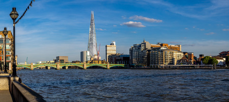 View along the Thames river in London. The office tower in the distance is the Shard and is the tallest office building in Europe. Redakční