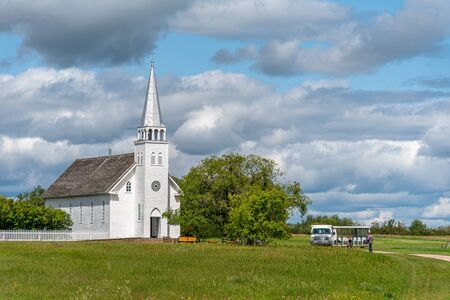 Batoche, Saskatchewan - August 6. 2019: Saint Antoine de Padoue Church located next to the Rectory in Batoche National Historic Site of Canada. It was built using a Red River frame construction.