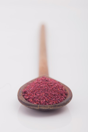 Sumac spice on white background