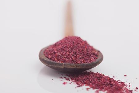 lemony: Sumac spice on white background