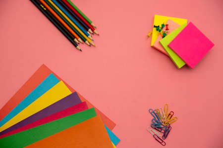 Multi-colored pencils on a pink background. Place for text Foto de archivo