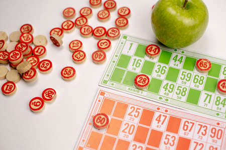 Wooden kegs, cards and chips for a game in a lotto