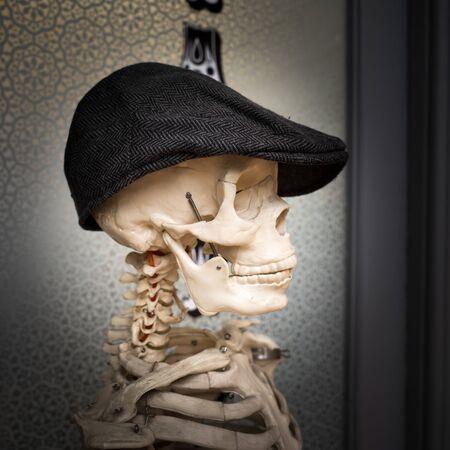 Skeleton in a Flat Cap, Medical Skeleton Stock Photo