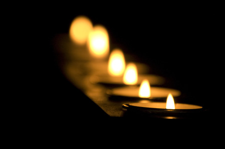 Candles in a row with dark background Stock fotó - 94371187