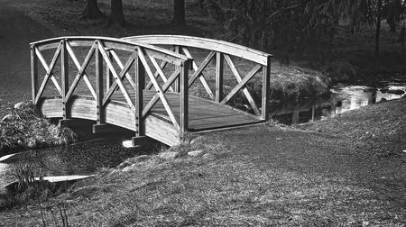 Small wooden bridge in black and white. Banco de Imagens